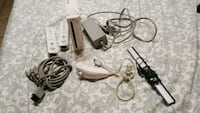 black Nintendo Wii console with controller and game cases Escondido, 92025