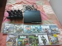 black Sony PS3 slim console with controller and game cases Ottawa, K1V 8Y4