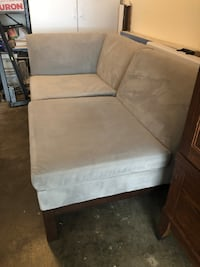 Wraparound grey couch (30 inches high x 33 wide x length in details) Chevy Chase