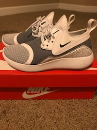 Pair of gray nike running shoes with box Portland, 97209