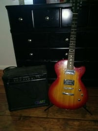 maple burst electric guitar and black Crate amp