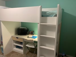 Loft bed with attached desk and storage