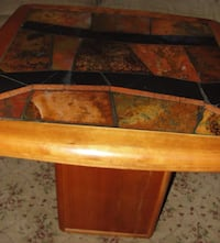 """Cherry Veneered Table 12"""" x 12"""" x 19"""" base with 27 1/2"""" square multi-color top that is 21"""" tall and was made in South Africa. Wood is in good condition .. some tiles have light marks. I was not sure what to use to polish them so I will let that up to you. Bristol, 19007"""