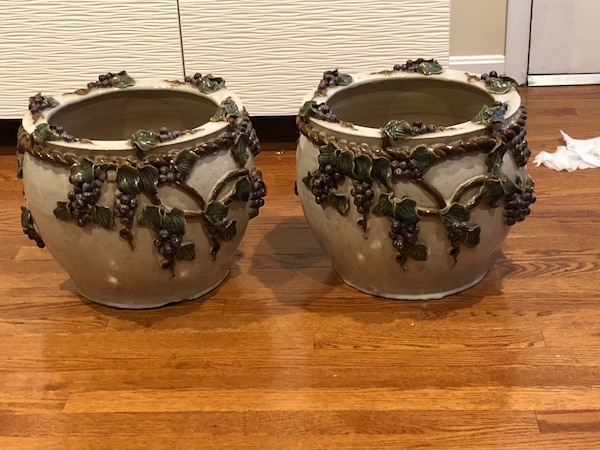 Two brown-and-white grape vines ceramic canisters