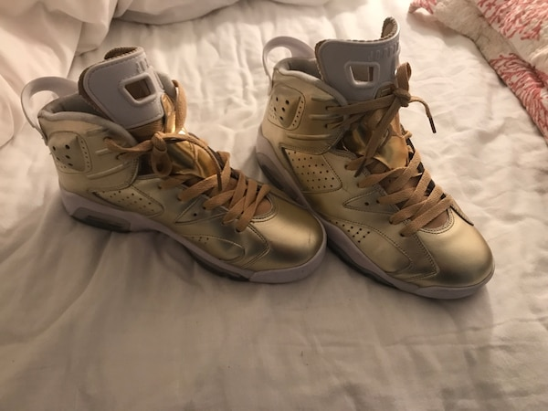 pair of gold-colored basketball shoes