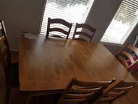 Rectangular brown wooden table with four chairs dining set Calgary, T1Y 5B9