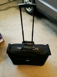 black garment luggage bag