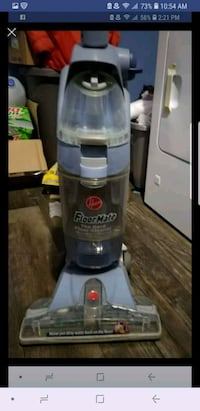 gray and blue Hoover upright vacuum cleaner  Portage, 46368