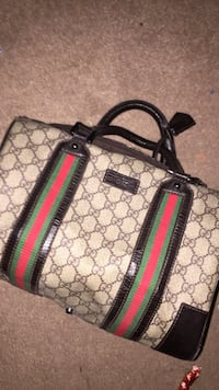 gray, green, and red Gucci handbag
