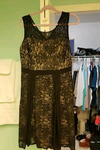 Black lace dress with tan skirt underneath. Size XL.
