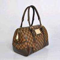 monogrammed brown Gucci leather handbag Bronx