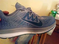 unpaired blue and white Nike running shoe New Iberia, 70563