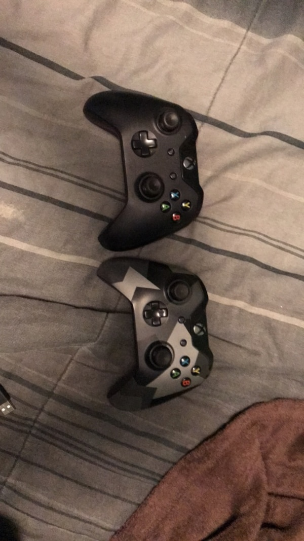 Xbox one controllers. 1 with rechargeable battery pack 9867a284-f12e-4c86-ace9-d220f965f45a