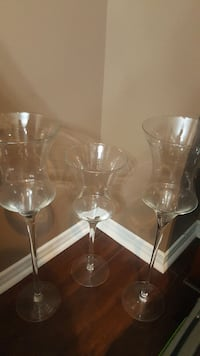 three clear glass candle holders