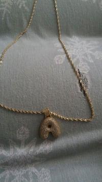 silver-colored chain necklace with pendant Houston