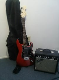 red and black electric guitar with amplifier Mount Pleasant, 84647