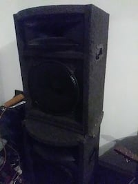 two black subwoofers with enclosure
