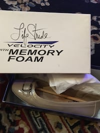 Pair of gray life stride velocity with memory foam leather flats, and white box Portage, 53901