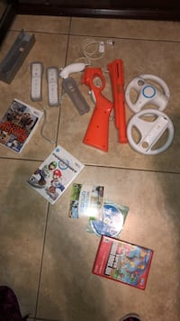 Wii console with games and controls  1486 mi