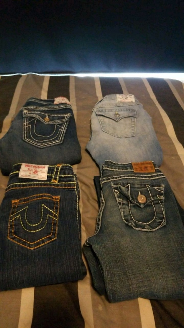 two blue True Religion jeans 48bb07f2-aebc-49c4-9b2d-ec3129b914fd