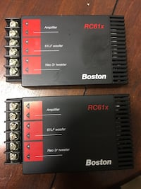 Two black-and-red boston amplifiers