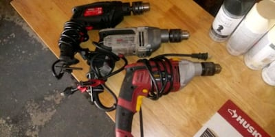 3 corded drills 2 of which are hammer drills