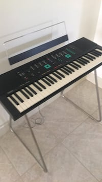 Black and white electronic keyboard original cost $1800.00 great buy for $125.00 stand included Yamahas model psr 80 Hudson, 34667