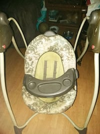 baby's gray and white Graco swing chair