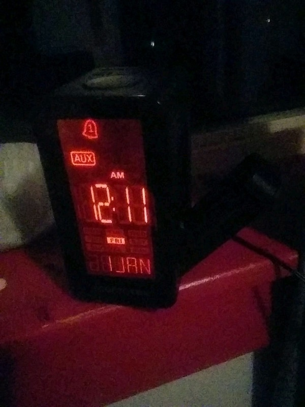 black and red Milwaukee battery charger