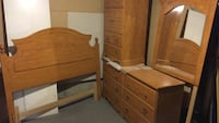 Queen bedroom set with headboard and rails, chest and dresser with mirror in excellent condition 725 km