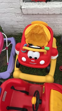 toddler's red and yellow Little TIkes activity walker