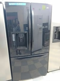 gray french door refrigerator with dispenser