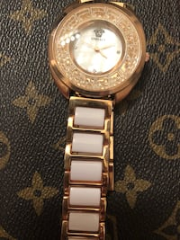 round gold analog watch with gold link bracelet Henderson, 89011