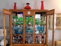 brown wooden framed glass display cabinet Edmonton, T6G 2V7