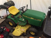 green and yellow John Deere ride on lawn mower GLADWIN