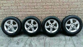 four mazda 3  rims with tire sets
