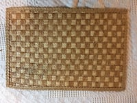 Set 8 fine straw mats with ric-rac like edge.   Very clean.  Vintage Greenville, 29609