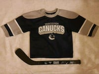 Toddler canucks jersey and hockey stick