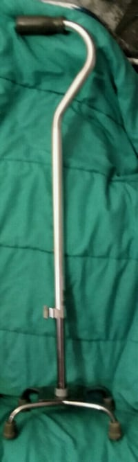 4 footed walking cane, padded handle. Sturdy and adjustable