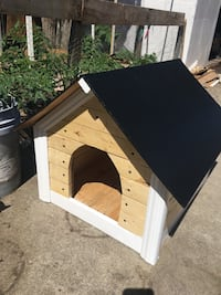 brown and white wooden doghouse