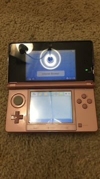 Pink nintendo 3ds with games and case