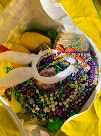 *Christmas parade throws* Mardi Gras beads and toys