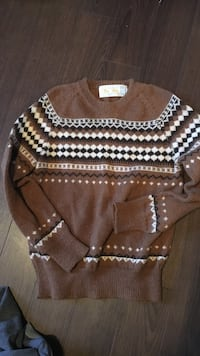 brown, white, and black aztec print sweater. Size m
