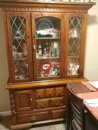brown wooden framed glass display cabinet Winchester, 40391
