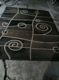L a rge area rug.Clean, no holes,snags,stains.Or.  2345 mi