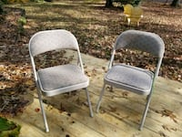 two gray metal folding chairs 39 mi