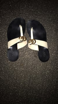 Pair of black-and-white leather sandals Burnaby, V5G 4C6