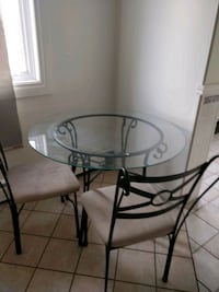 round glass top table with black metal base Edmonton, T5H 2M4