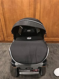 Black and gray chicco car seat and base  Grand Rapids, 49546