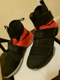 pair of black-and-red Nike basketball shoes Sterling, 20164